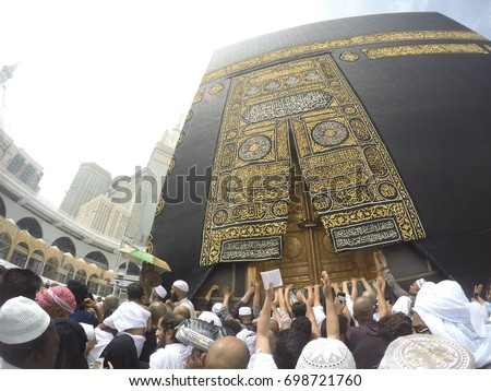 """MECCA, SAUDI ARABIA, April 13 2017 -Close Up Kaabah Haram Mosque in Mecca.The door of the Kaaba called """"Multazam"""".Muslim Devotees Trying To Touch The Golden Door Of Kaabah."""