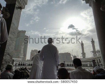 MECCA, SAUDI ARABIA - May 13, 2012: Muslim pilgrims from all over the world gathered to perform Umrah or Hajj at the Haram Mosque in Mecca. Image contain certain grain or noise and soft focus.