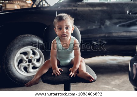 Mechanic Baby Boy - Sitting near the old car