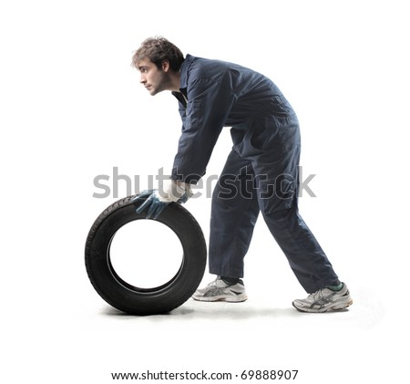 Mechanic carrying a tyre
