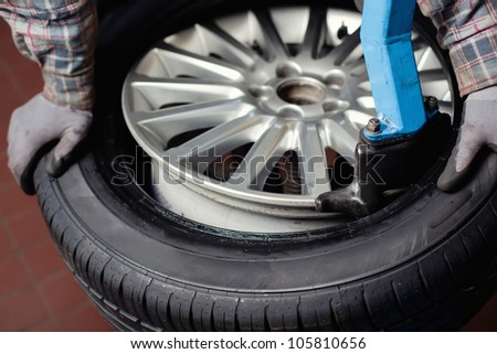Mechanic changing  car tire closeup