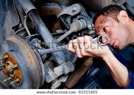Mechanic fixing a car at the garage