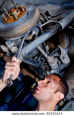 Mechanic fixing a car at the garage