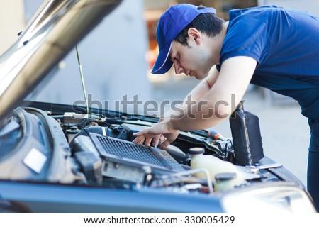 Mechanic fixing a car engine