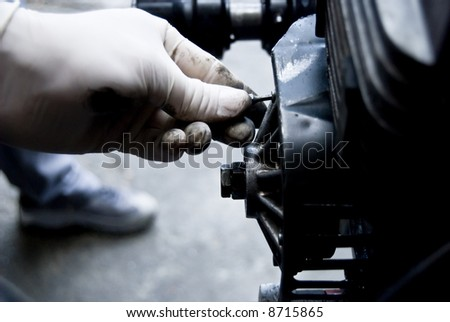 Mechanic fixing an engine , The Repair of the engine on stations of the technical maintenance. The Diagnostics and stripping.