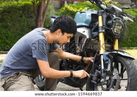Mechanic fixing motocycle worn motorcycle drum breaks shoes. Professional training, repairing motorbike.
