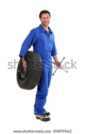 mechanic holding a tire