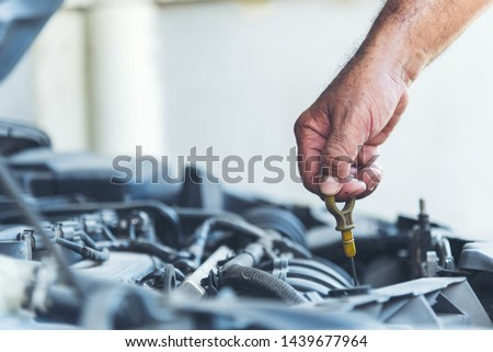 Mechanic man car service repair automobile garage autocar vehicles service mechanical man engineering. Automobile mechanical close up hands fixing car repairs. Mechanic technician workshop center