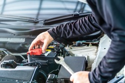 Mechanic man check battery pole cover, inspection and maintenance car service