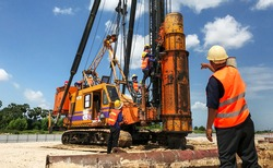 mechanic repair heavy machine in construction site