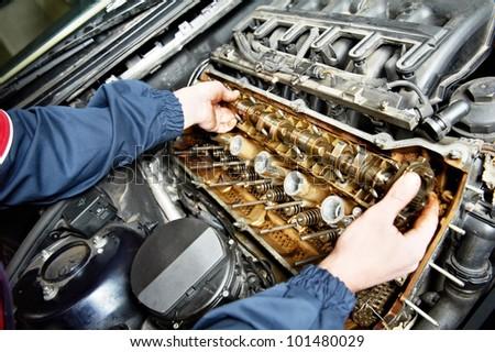 mechanic repairman at automobile car engine maintenance repair work