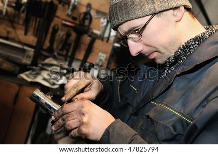 mechanic repairman at repairing work an car unit