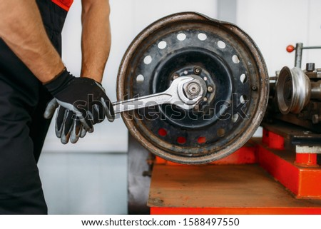 Mechanic repairs a crumpled disc, tire service