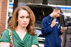 Mechanic: Upset Customer With Rip Off Mechanic In Background