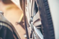 Mechanic wheel car object service repair garage autocar vehicles service mechanical man engineering. Automobile mechanical close up car wheel repairs. Mechanic technician workshop center