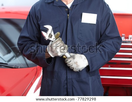 Mechanic with wrench.  Auto repair shop service. - stock photo