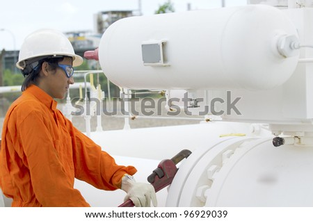 Mechanic worker is being work while to open bolt and nut of valve.