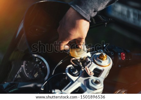Mechanic working on Motocycle in mechanics garage. Repair service. authentic close-up shot #1501896536