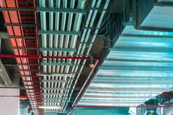 Mechanical and electrical services on the ceiling in a construction site.