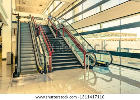 Mechanical and normal stairways at onterior view of modern building #1311417110