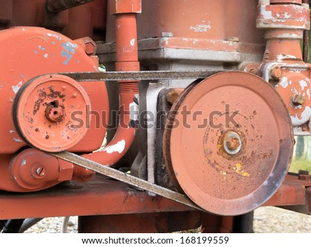 Mechanical belt driven gear wheels on an engine for power transmission from one shaft to another stock photo