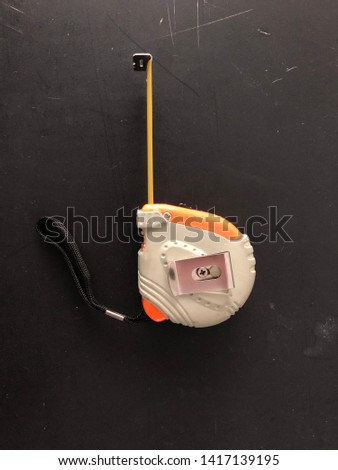 Mechanical device for measuring isolated on black background. #1417139195