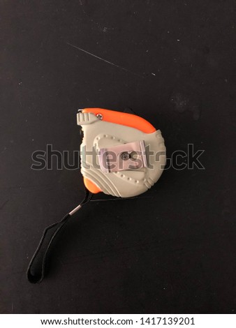 Mechanical device for measuring isolated on black background. #1417139201