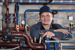 Mechanical Engineer in the process maintenance of the heating system in the basement of an apartment house.