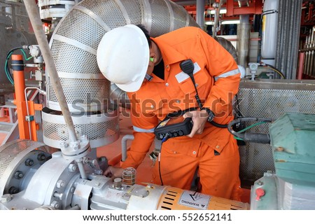 Photo of  Mechanical engineer measurement of centrifugal pump vibration and electric motor at offshore oil and gas central processing platform, Oil and gas exploration and production in the gulf of Thailand.