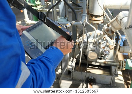 Photo of  Mechanical engineer use vibration meter to measurement of centrifugal pump vibration and electric motor at oil and gas plant or chemical factory.