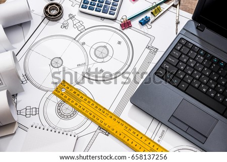mechanical engineering of parts with tools, laptop, drawing top #658137256