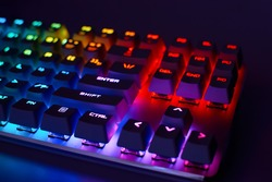 Mechanical gaming keyboard with backlight, close-up. Gaming keyboard with RGB backlight. RGB LED keyboard