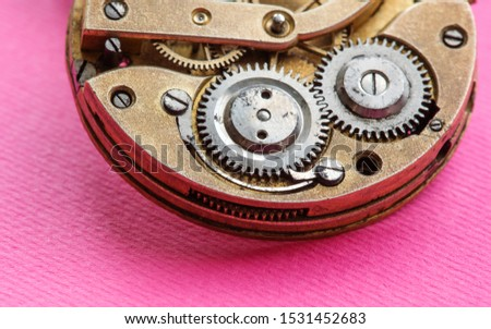 Mechanical instrument opened pocket watch chronometer mechanism close-up. Shallow depth of field, selective focus.