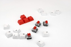Mechanical keyboard switch on a white background. WASD keyboard buttons. Concept of computer games, gaming and esports.