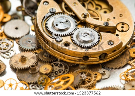 Mechanical machinery vintage clock mechanism. Ancient chronometer on aged cogwheels gears  background. macro view, shallow depth of field