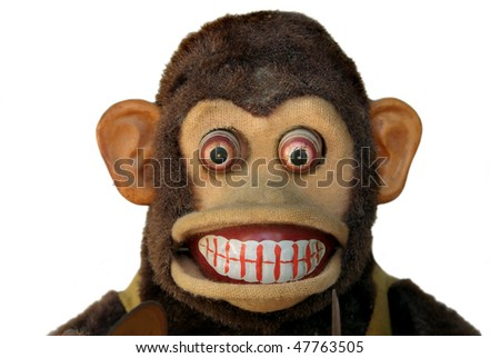 Mechanical monkey toy, close-up of face with teeth showing