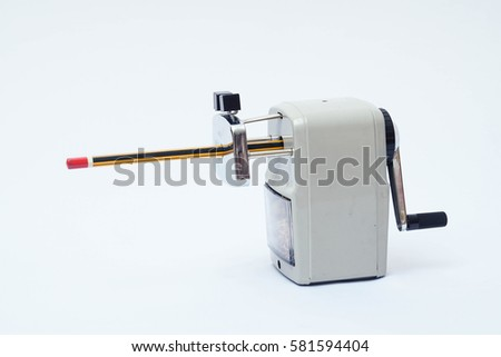 Mechanical pencil sharpener on isolated white background.  #581594404