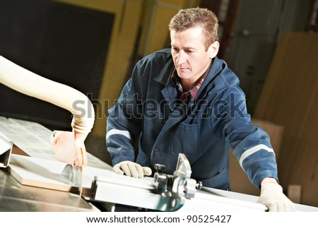 mechanical technician carpenter worker with circular saw machine at wood furniture manufacturing workshop