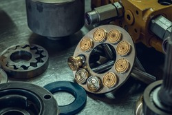 Mechanical workshop, hydraulic parts in the workshop. Grinding and polishing. Hydraulic pump repair.