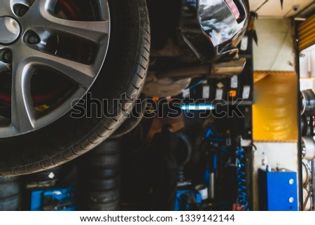 Mechanics working on tires in tire shop #1339142144