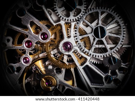 Mechanism, clockwork of a watch with jewels, close-up. Vintage luxury background. Time, work concept.