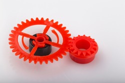 Mechanism made of red and plastic gearwheel.