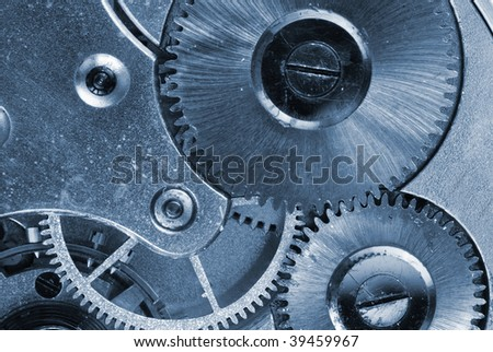 Mechanism of old clock - sprockets in the system are well visible, blue tint