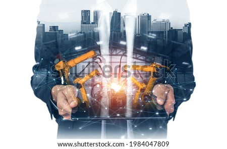 Mechanized industry robot arm and factory worker double exposure . Concept of robotics technology for industrial revolution and automated manufacturing process . Stock photo ©