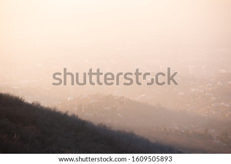MECSEK HILLS, HUNGARY - JANUARY 2020: Top of the hill wrapped with the morning fog at Mecsek hills near Pécs. Beautiful sunrise over hill.