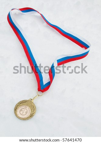 Medal and colour ribbon on a snow