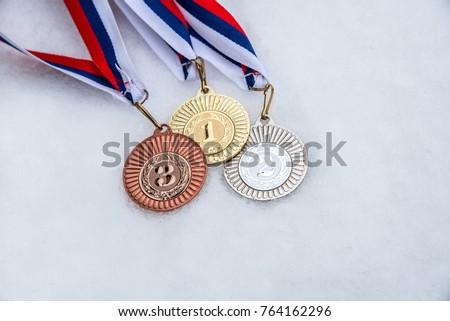 Medal, Award, Winning. White, snow background. Winter olympic game. South Korea 2018. #764162296