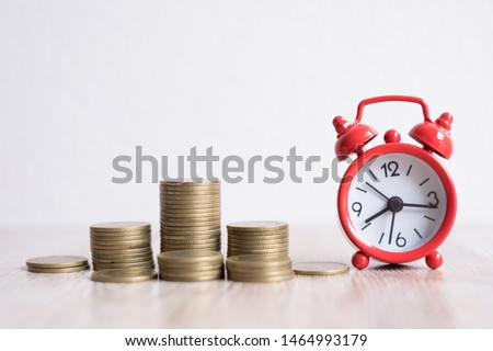 Medal Ladder Starting Business Growth.Financial concepts Creating a silver coin with investment alarm clock, saving money. Most of the time looking for money. Coins stack and alarm clock.