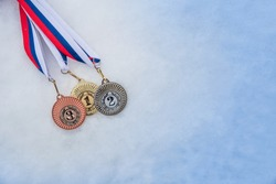 Medal set in winter snow background. Medal set, sport trophy. Original wallpaper for winter olympic game.