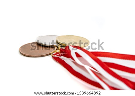 Medals isolated on white. Gold, silver and bronze medal on a dark background. The concept of tournaments and competitions. Victory, winning competitions. #1539664892